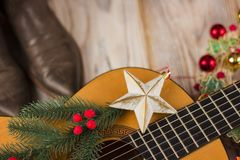 Country music background with guitar and christmas decoration Royalty Free Stock Photography