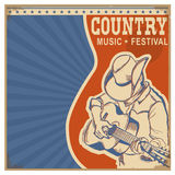 Country music background retro poster with man in cowboy hat an. American Country music background with text.Musician in cowboy hat  playing guitar Royalty Free Stock Photo