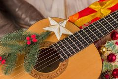 Country music christmas background with guitar and cowboy boots Royalty Free Stock Photos