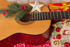 Country music christmas background with guitar and cowboy bandan. Country music christmas background with guitar and red bandanna Royalty Free Stock Photography