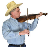 Country Music Musician Playing Violin or Fiddle Isolated. A cowboy from a country and western band is playing country music on a fiddle or violin. isolated on Royalty Free Stock Photography