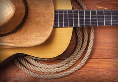 Country music picture with guitar and cowboy hat and rope Royalty Free Stock Photos