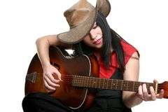 Country Musician. A woman playing country and western music on a guitar royalty free stock image