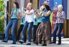 Country musicians and Line-dancers Stock Image