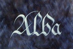 Country name. Scotland Alba. Painted country name over dark background. Scotland Alba. Latin medieval gothic script. Scottish Gaelic language Royalty Free Stock Photography