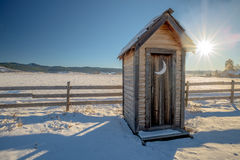 Country out house with snow and fence Stock Image