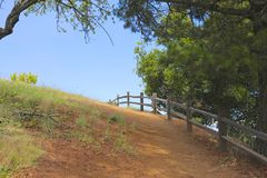 Country Path. Over the hill near cow fence Stock Photography