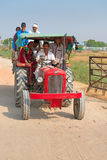 Country people travel by tractor, India Royalty Free Stock Images