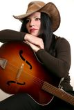 Country performer and guitar. Country performer resting on her acoustic guitar stock photography