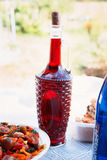 Country picnic with bottle of wine Royalty Free Stock Photos