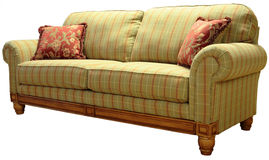 Country Plaid Sofa. Green Country Plaid Sofa with Pine Accent Trim Royalty Free Stock Photos
