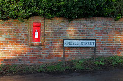 Country postbox and road sign Royalty Free Stock Photo