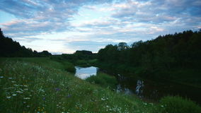 Country river. Panoramic time-lapse of river in dusk stock video footage