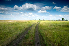 Country road. Stretching out into the beautiful landscape Royalty Free Stock Photography