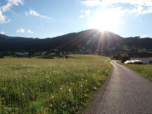 Country road. Sunshine on the country road .Shot in Gosau village, salzkammergut of Austria Royalty Free Stock Images