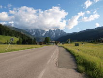Country road. Sunshine on the country road .Shot in Gosau village, salzkammergut of Austria Royalty Free Stock Image