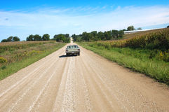 Country road. A car travelling down a gravel road in rural Warren County, Iowa Royalty Free Stock Image