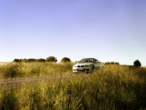 Country Road. Shot of a car driving on a country road stock images