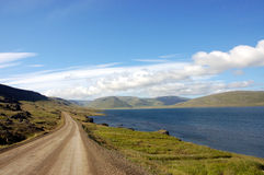 Country road. Rural road along the fjord in west part of Iceland Stock Photos