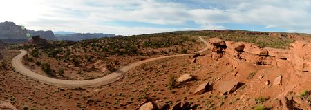 Country Road. Sweeping bend curve in a dirt desert road Royalty Free Stock Photo