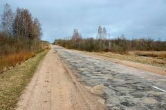 Country road. Old repaired road in countryside Royalty Free Stock Photography