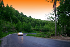 Country Road. Car at dusk on road. Country road and car stock photography