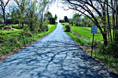 Country Road. Private country road in Maryland, USA, sign beside road says No Thru Traffic Royalty Free Stock Images