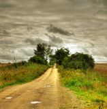 Country road. A scenic country road and dramatic cloudscape Stock Photo