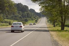 Country Road. A beautiful country road with a sprinkling of cars Stock Images
