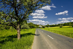 Country road. Lonely country road in the franconian country side in germany Stock Photography