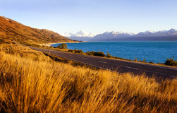 Country Road With Amazing Scenery Of Lake Stock Photo