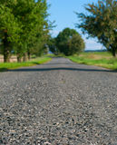 Country Road. Country Asphalt Road - Shallow Depth of Filed. Focus on Front Part of Road stock image