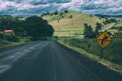 Country road in attractive landscape Stock Images
