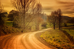 Country road in Australia. Country dirt road and farmland in the outer Leongatha district in Victoria, Australia royalty free stock image