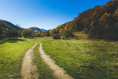Country road autumn colours Royalty Free Stock Photo
