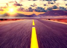 Country road background and colorful sunset landscape royalty free stock photo