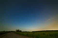 Country road on background of the starry night sky. Royalty Free Stock Photography