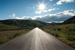 Country Road In Backlit Royalty Free Stock Images
