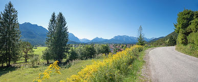 Country road in bavarian mountainous landscape Stock Photo