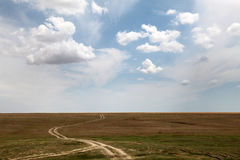 Country road and beautiful clouds. Road at countryside in Ukraine . Photo for background Stock Photos
