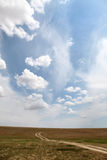 Country road and beautiful clouds. Road at countryside in Ukraine . Photo for background Stock Photo