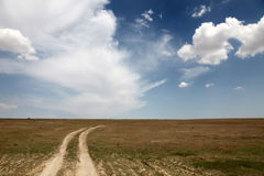 Country road and beautiful clouds. Road at countryside in Ukraine . Photo for background #6 Royalty Free Stock Photo