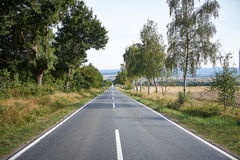 Country road on a beautiful sunny day Stock Images