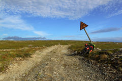 Country road, bike and old road sign. Outdoor country road, bike and old road sign in north Royalty Free Stock Photos