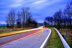 Country Road at Blue Hour, Brescia Province, Italy. Abstract representation of vehicle light in a country road at blue hour, Italy Royalty Free Stock Photos
