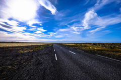 Country road with blue skies Royalty Free Stock Images