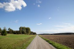 Country road blue sky. stock photo