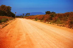 Country road with the blue sky. Stock Image