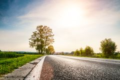 Country road with broken curb stock images