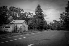 Country Road BW. GARDINER, NEW YORK -SEPTEMBER 28 - An old country road with an abandoned roadside store on September 28 2015 near Gardiner NY Royalty Free Stock Photo